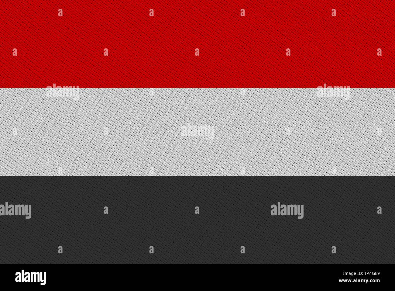 Yemen fabric flag. Patriotic background. National flag of Yemen - Stock Image