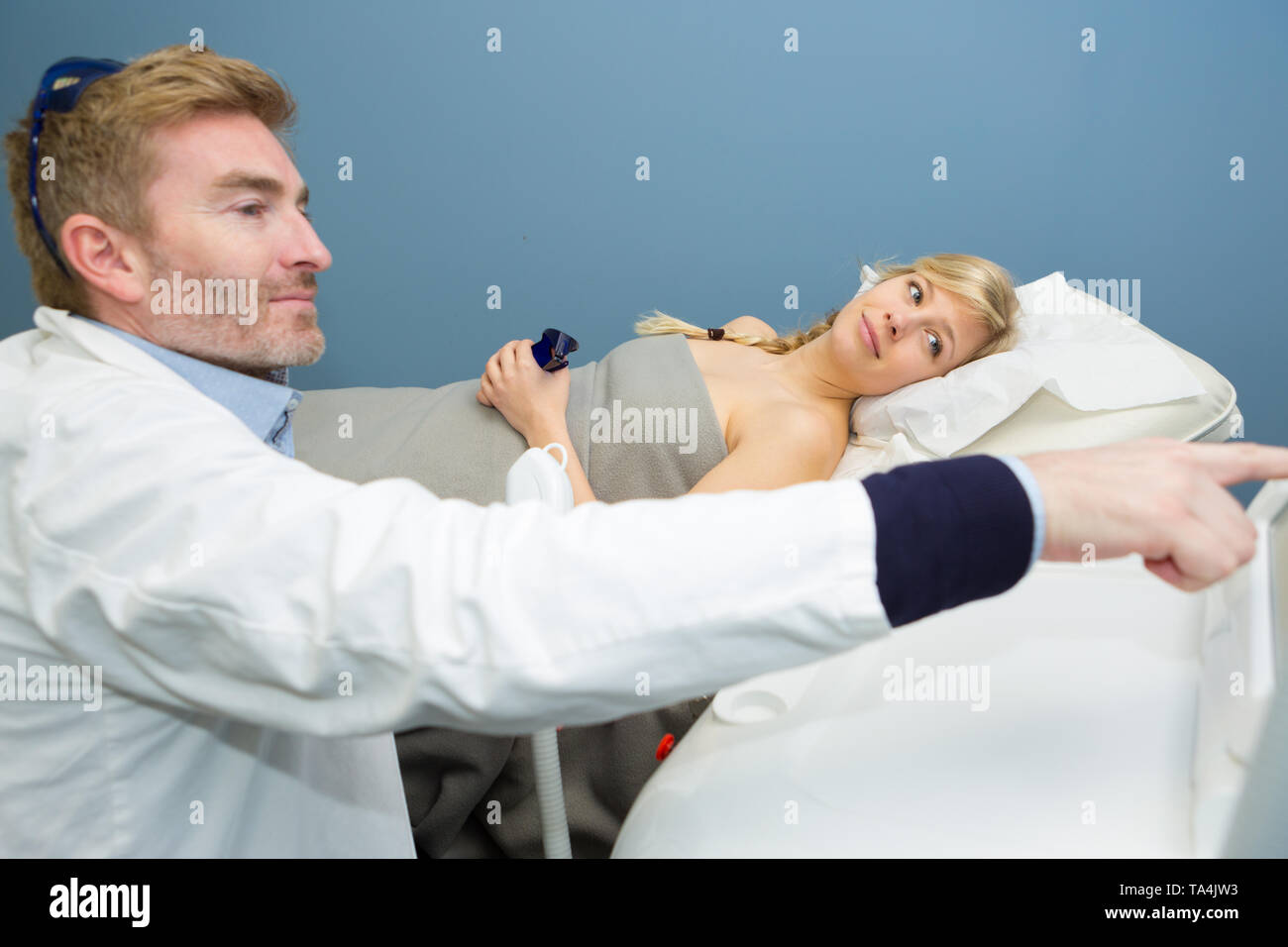pregnant woman checking her echography - Stock Image