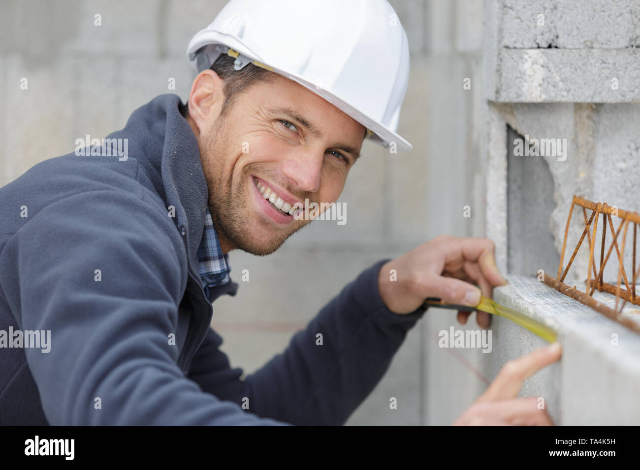 man working on concrete structure - Stock Image