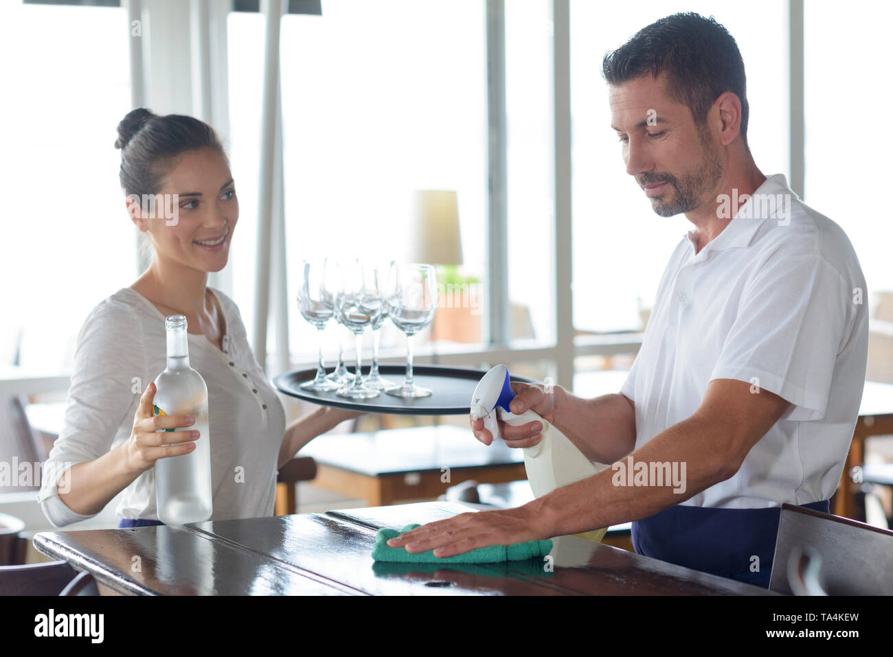man and woman working on bar - Stock Image