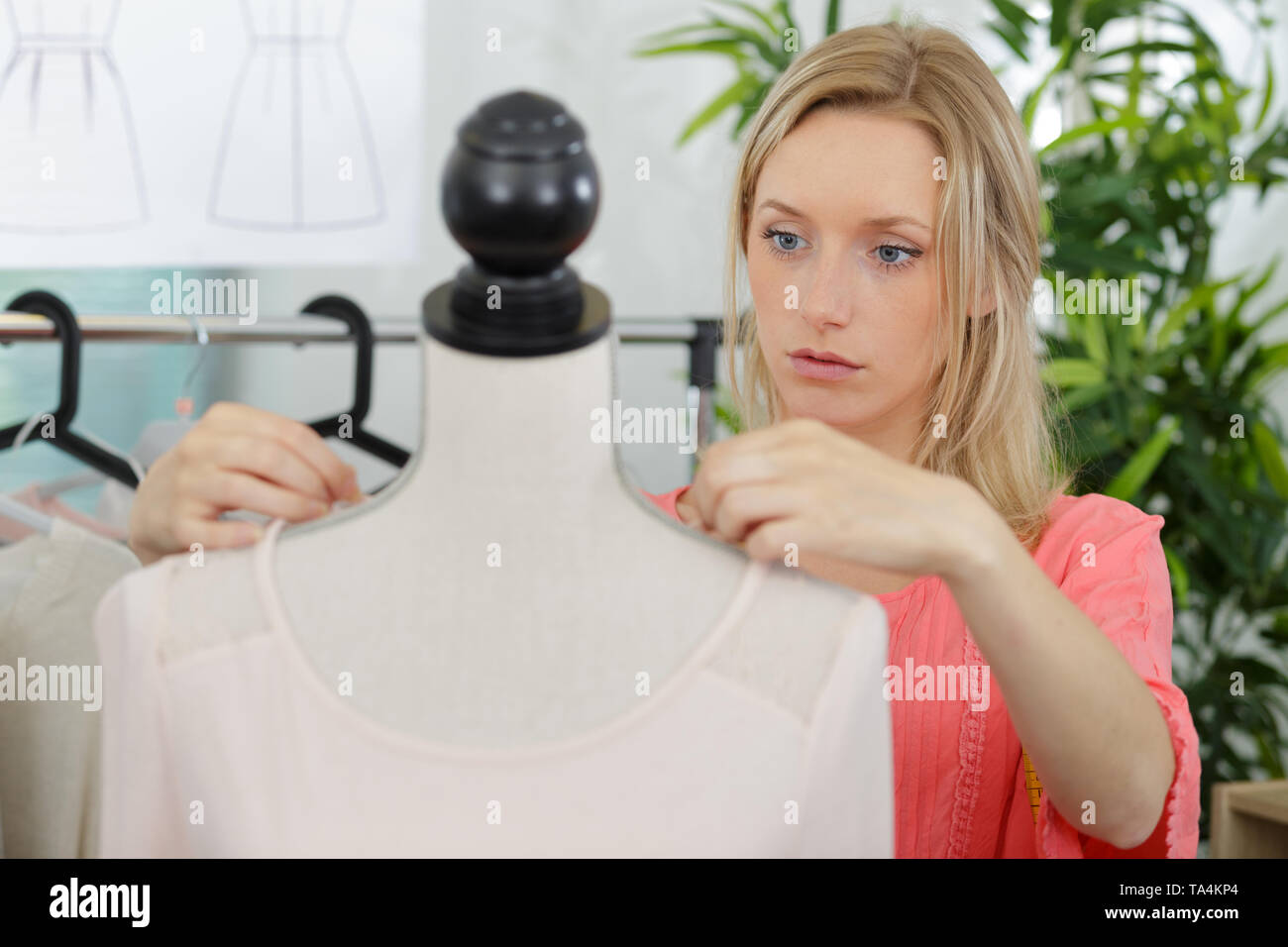 woman tailor working on new clothing - Stock Image
