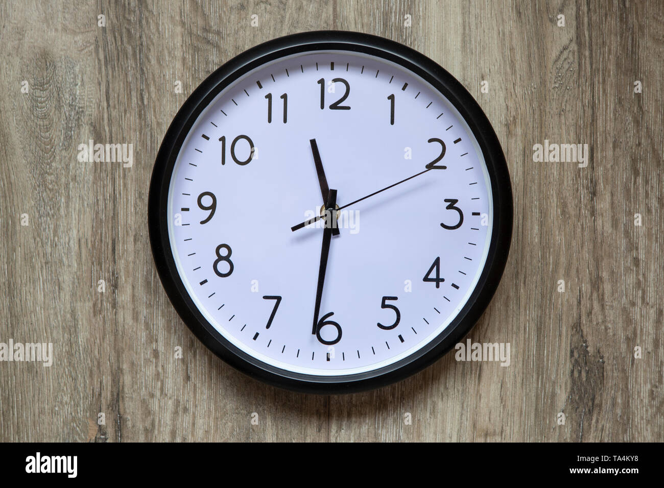 Blank clock face with hour, minute and second hands Stock Photo