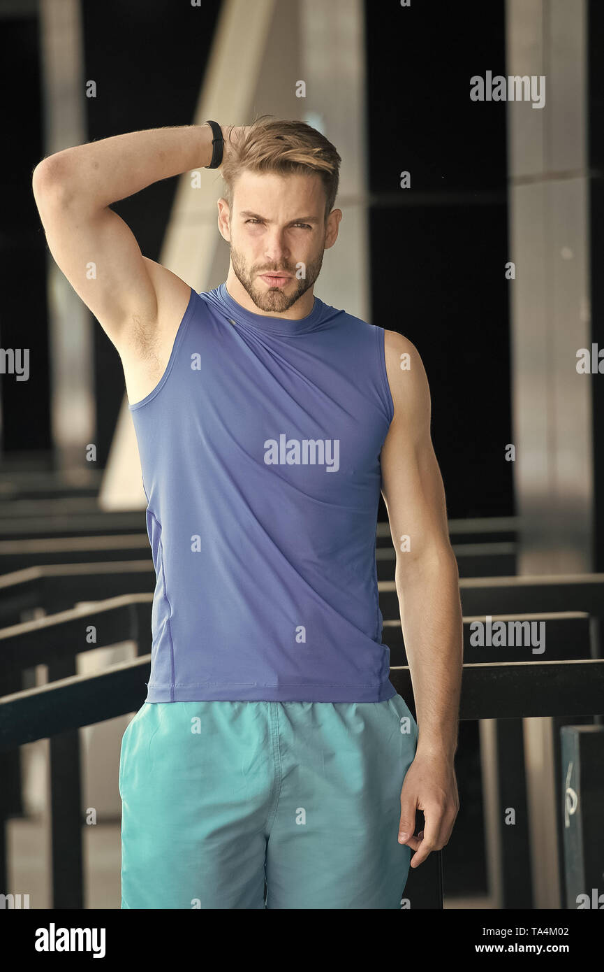 Man unsatisfied his antiperspirant. Sportsman after training feel sweat smell. Guy check armpit sweaty skin. Prevent or reduce perspiration. Choose proper antiperspirant or deodorant for training. - Stock Image