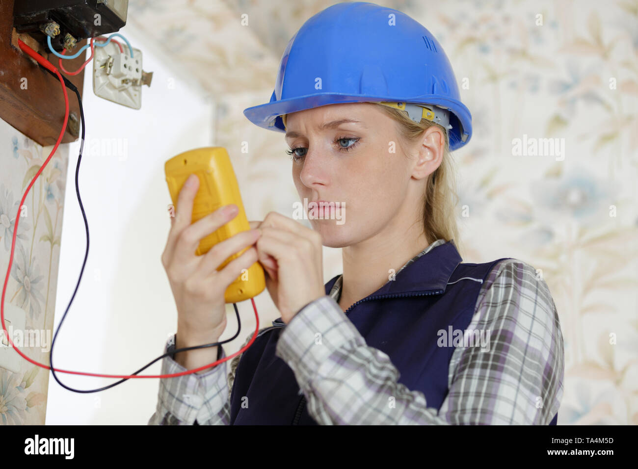 female electrician or engineer check or inspect electrical system - Stock Image