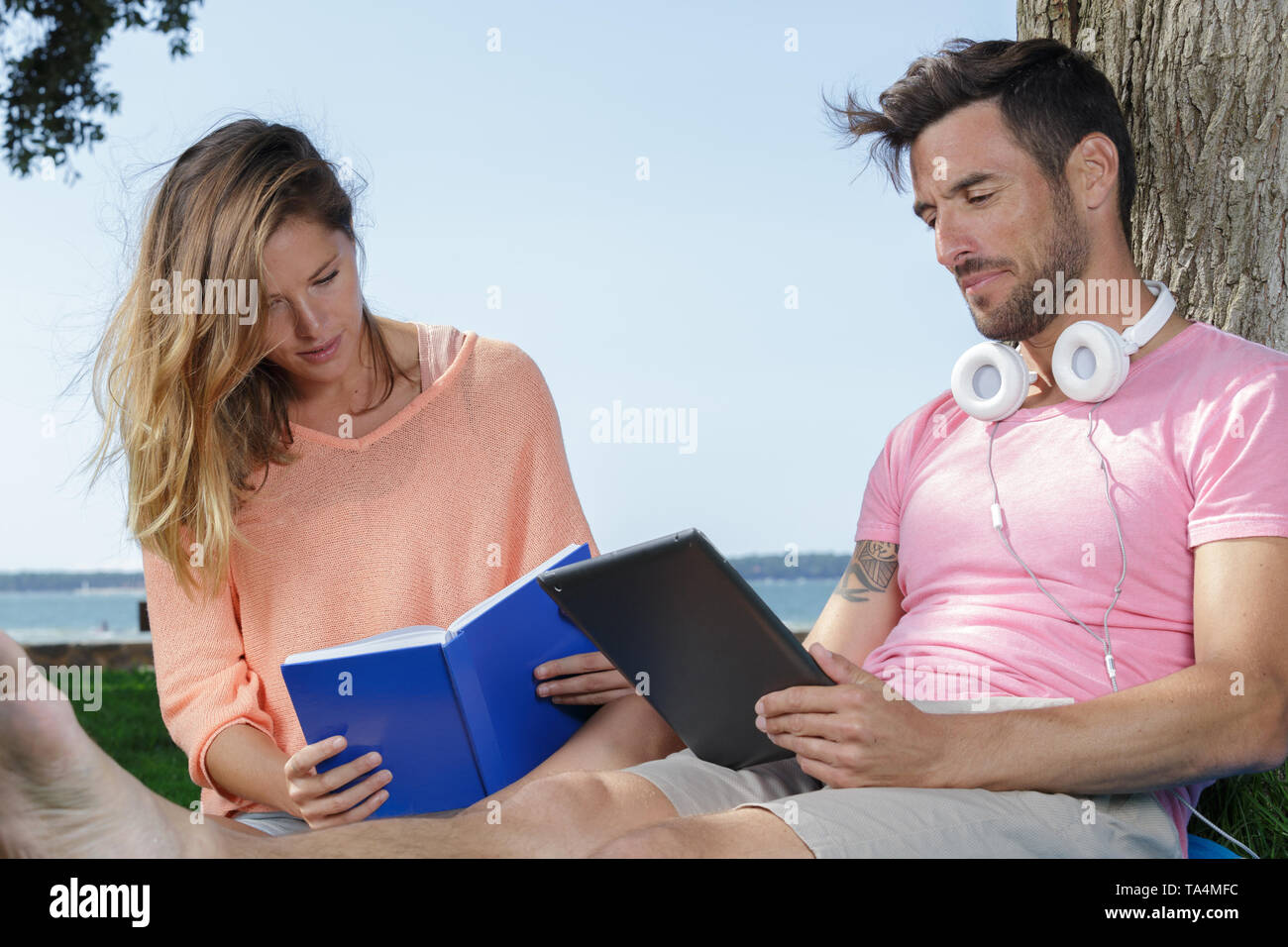 young couple relaxing at the beach - Stock Image