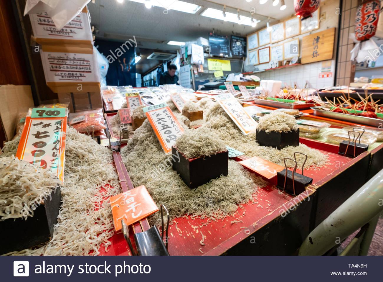 Lacquered wood bins containing various traditional Japanese food items for sale in Nishiki Market, Higashiuoyacho, Nakagyo-ku, Kyoto, Honshu, Japan - Stock Image