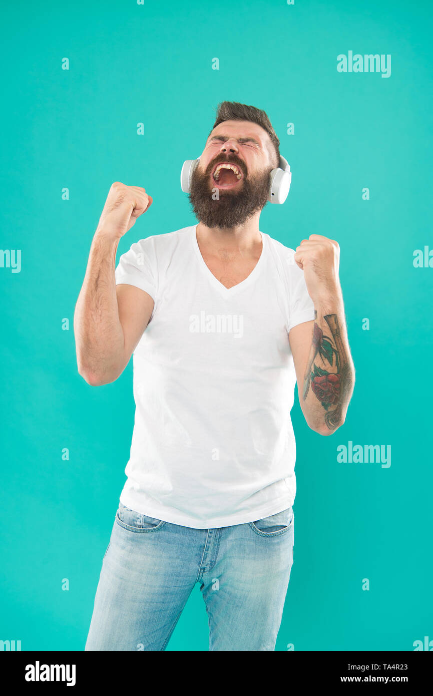 Free online music sources all work little bit differently and have many different features. Music chart. Mature hipster with beard listening music. Stylish and handsome music lover. Man in headphones. - Stock Image