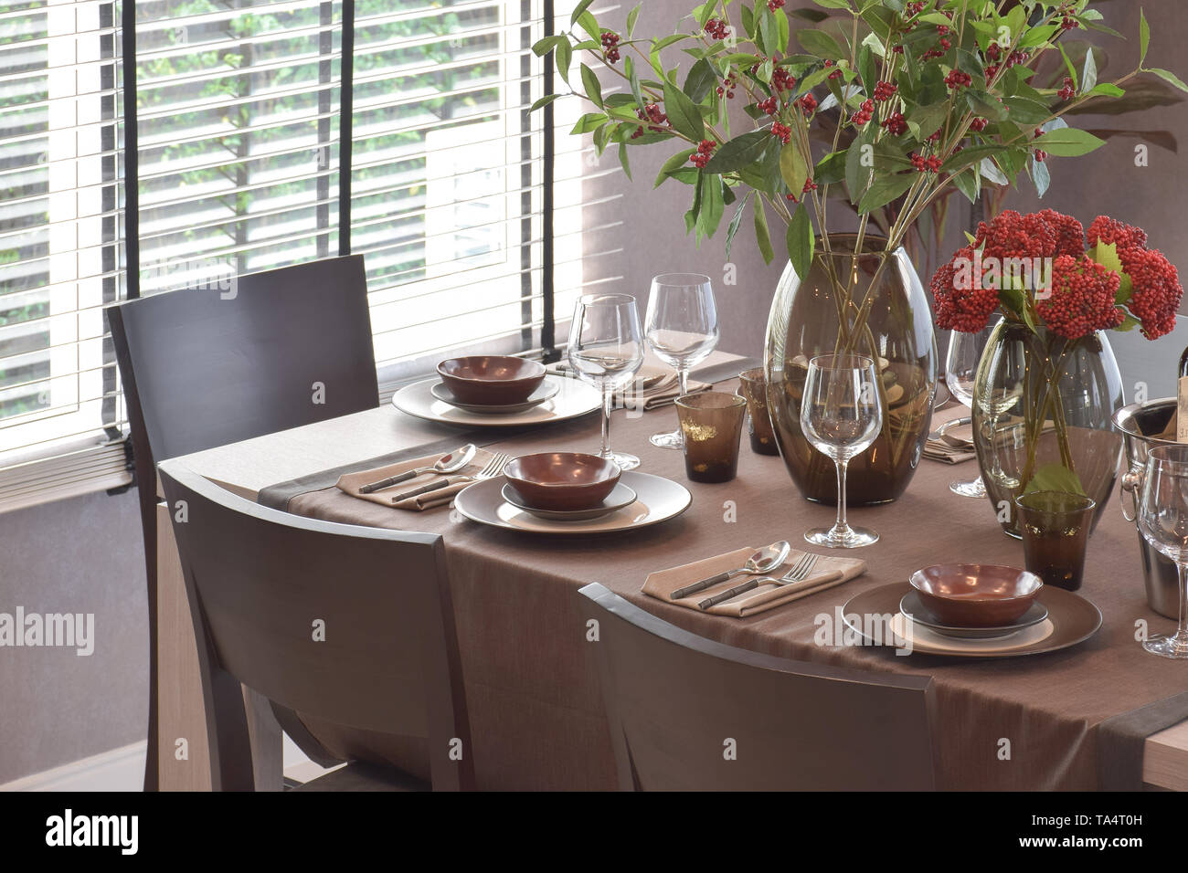 Modern classic dining set in luxury dining room - Stock Image
