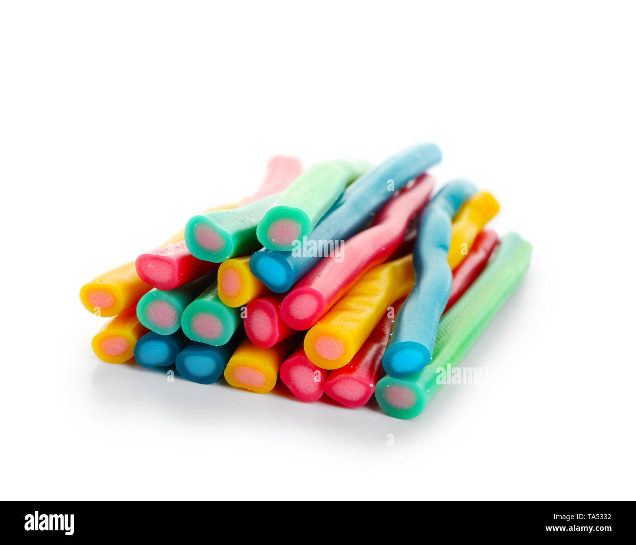 Sweet candy sticks on white background - Stock Image