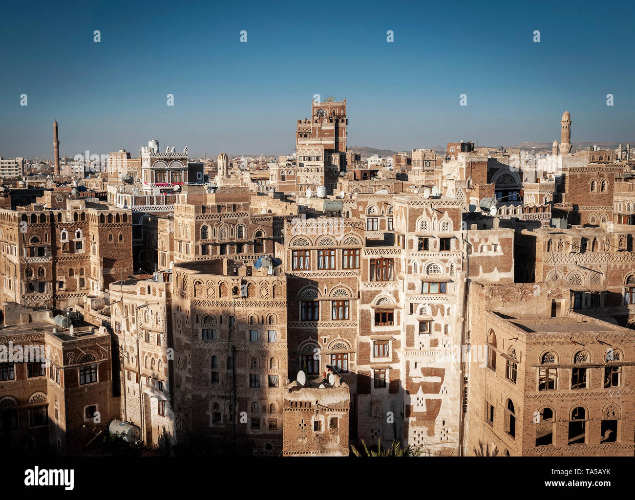 view of  downtown sanaa city old town traditional arabic architecture skyline in yemen - Stock Image