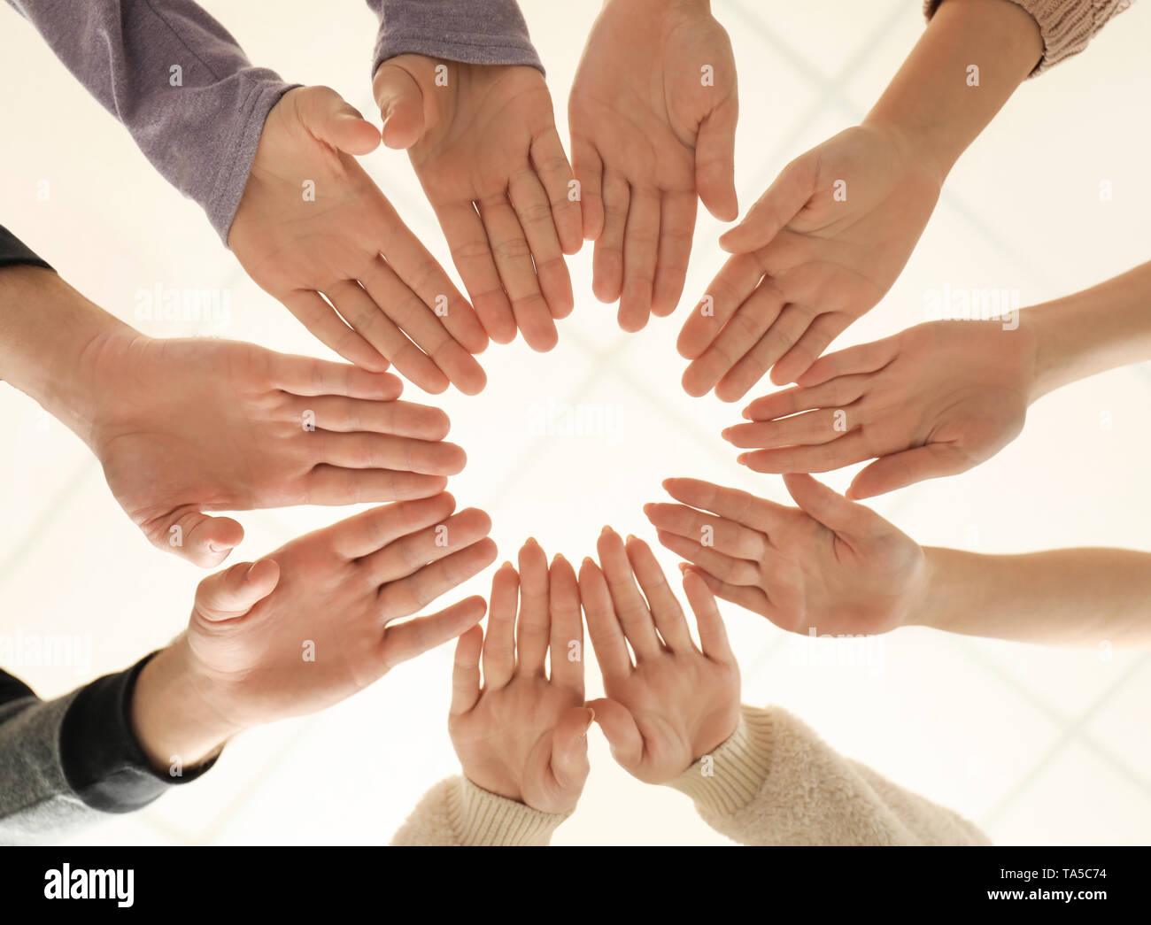 People Putting Hands Together As Symbol Of Unity Stock Photo Alamy