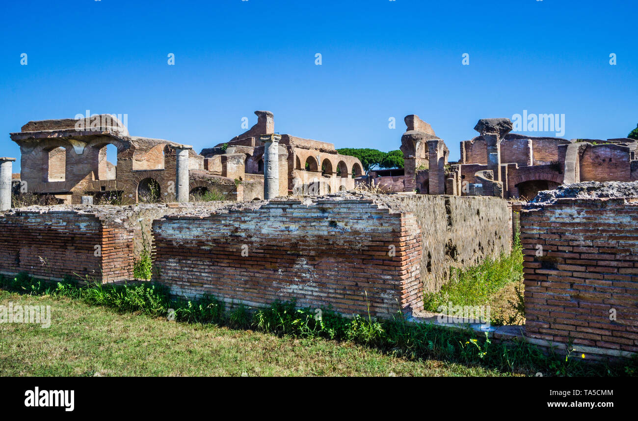 House of the Charioteers (Caseggiato Degli Aurighi) at the  archeological site of the Roman settlement of Ostia Antica, the ancient harbour of the cit - Stock Image