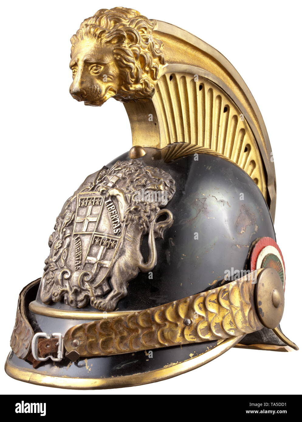 A helmet of the Savoy horseguard militia, circa 1850 Skull of black lacquered brass sheet. Gilt embossed comb, the front embellished with a large, elaborate lion head relief. Silver plated emblem with the large coat of arms of Savoy, one-piece embossed chinscales on smooth rosettes, left with original leather cockade, green underlined visors. Well preserved lining of tender brown leather (with loops). Signs of wear and age. Only slightly worn, in untouched original condition. historic, historical, Italian, Europe, European, 19th century, Additional-Rights-Clearance-Info-Not-Available Stock Photo