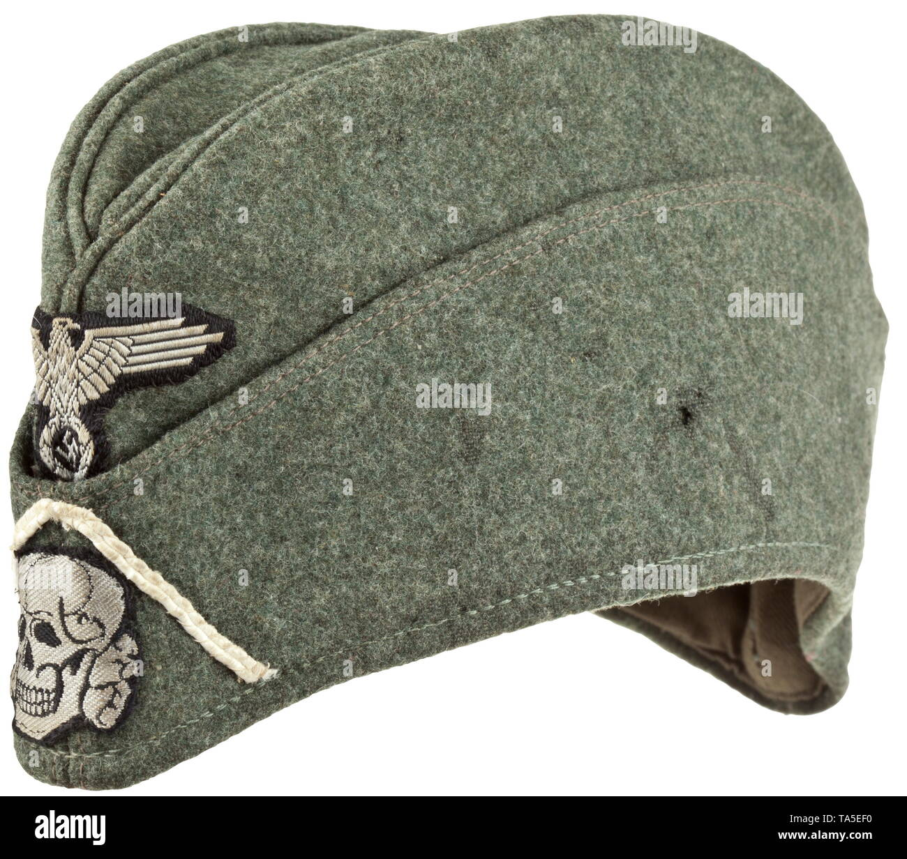 """A garrison cap for enlisted men/NCOs of Waffen-SS infantry units depot piece Field-grey woollen cloth in SS """"boat-shaped"""" cut with stitched-in cap piping in base cloth, brown cotton liner with stamping """"Schmid & Menner"""" and size 59. Hand-stitched, silver-grey on black woven BeVo insignia, white soutache chevron. Unused, with moth traces. historic, historical, 20th century, 1930s, 1940s, Waffen-SS, armed division of the SS, armed service, armed services, NS, National Socialism, Nazism, Third Reich, German Reich, Germany, military, militaria, utensil, piece of equipment, uten, Editorial-Use-Only Stock Photo"""