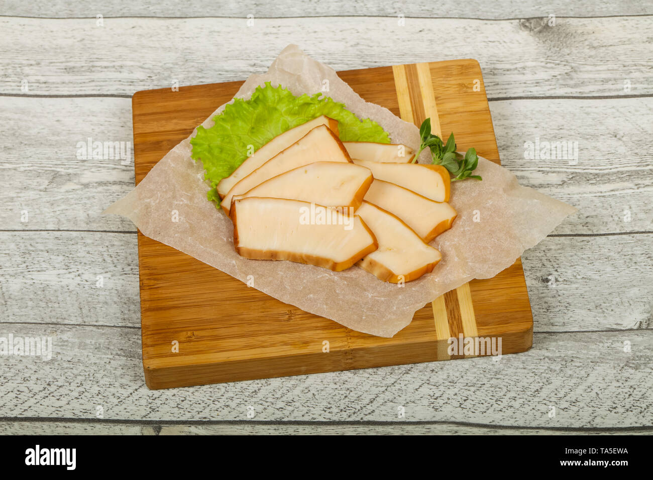 Sliced smoked squid served salad leaves - Stock Image