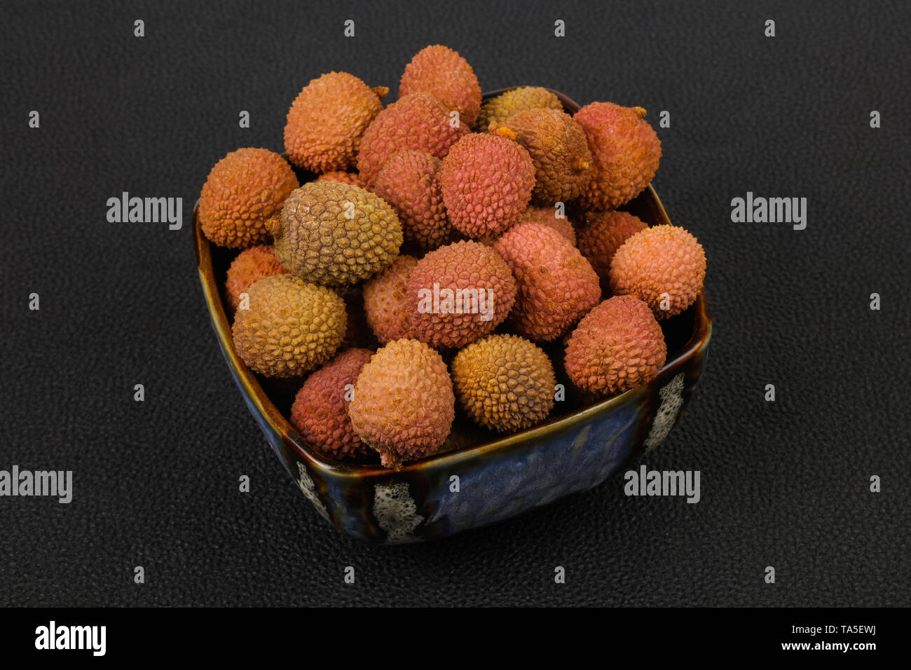 Tropical fruit lychee in the bowl - Stock Image