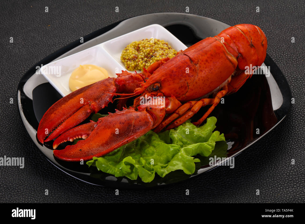 Luxury Lobster with sauces - ready for eat - Stock Image