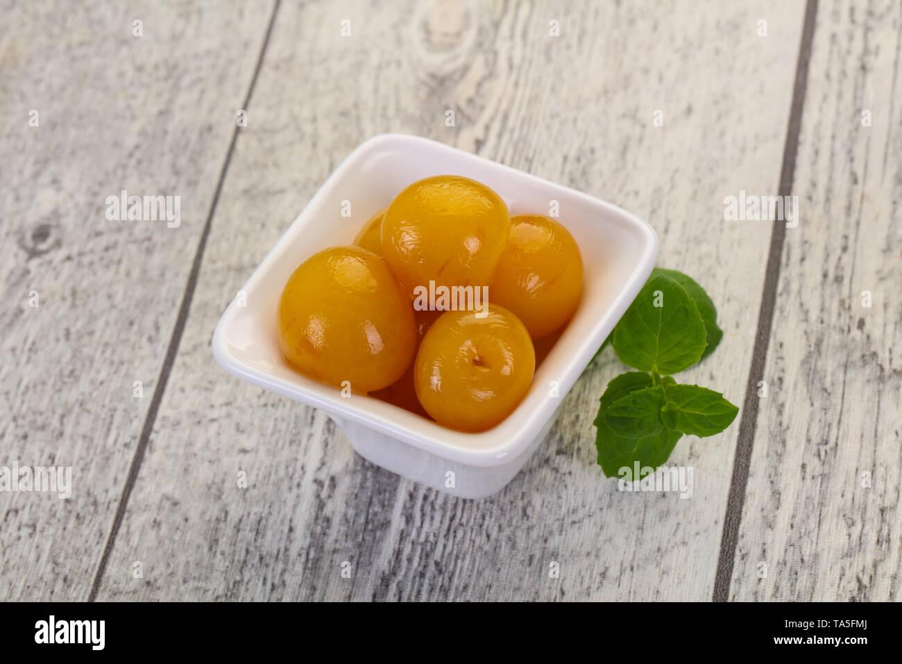 Yellow ripe cherry dessert in the bowl - Stock Image