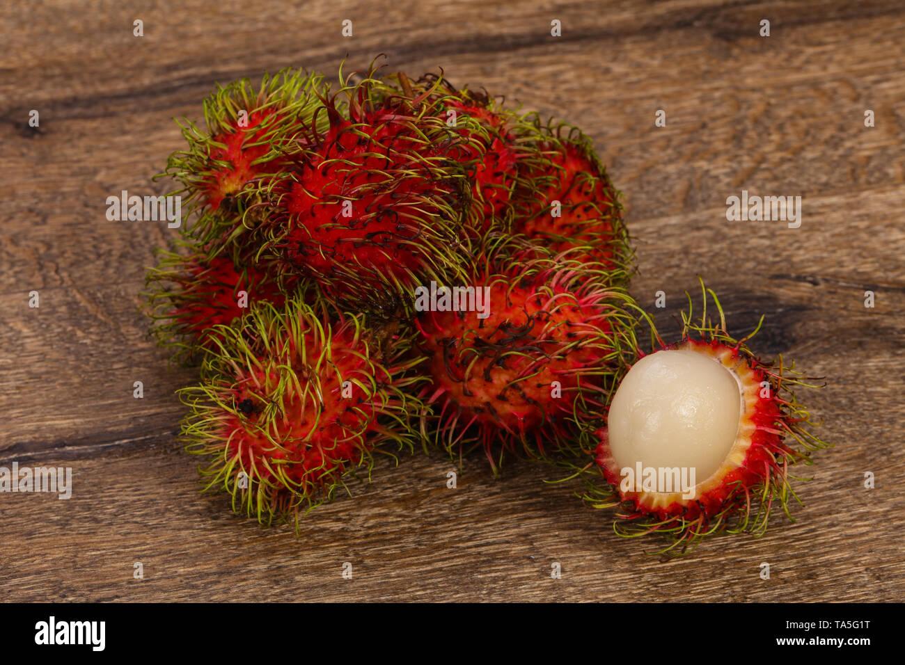 Tropical sweet exotic fruit Rambutan heap - Stock Image
