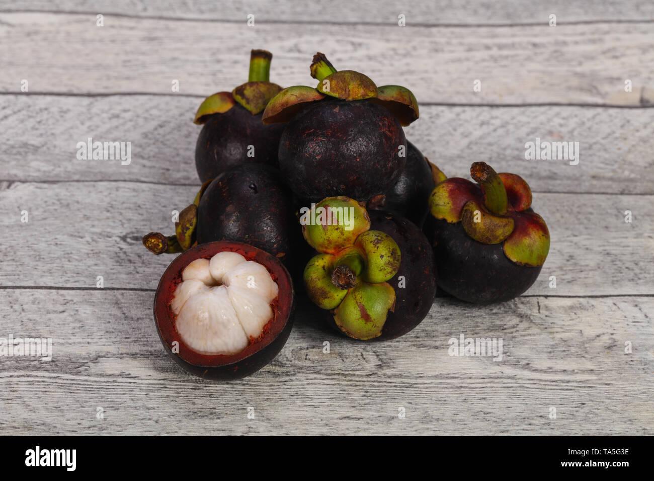 Ripe Sweet delicous exotic fruit - Mangosteen - Stock Image