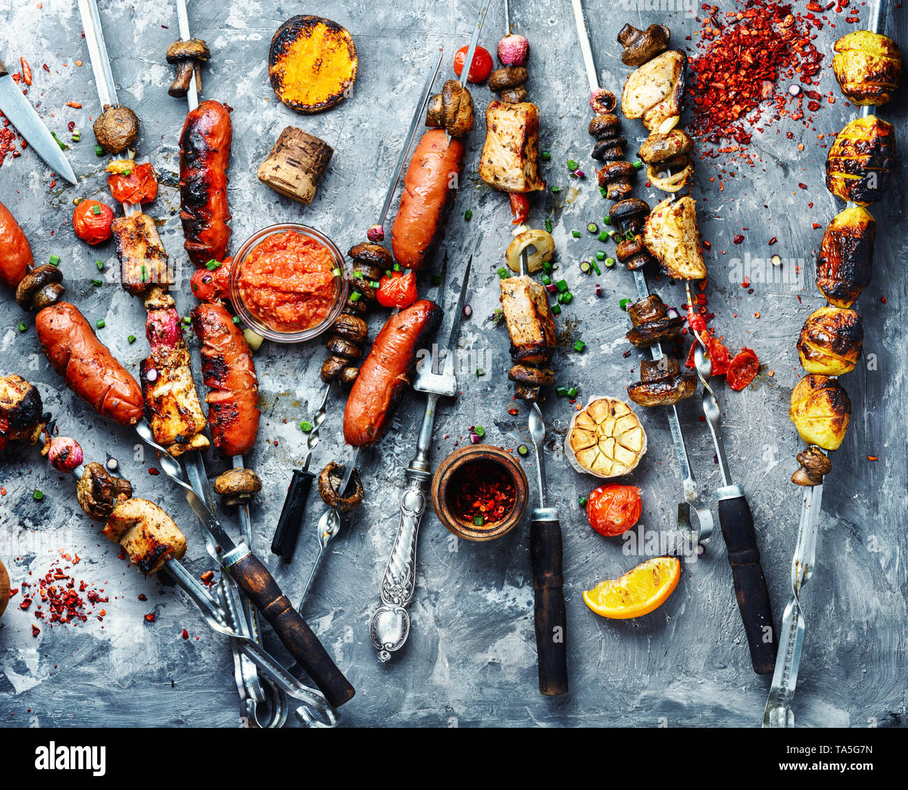 Set of grilled dishes, kebabs, sausages and grilled vegetables.Fast food. Eastern food - Stock Image