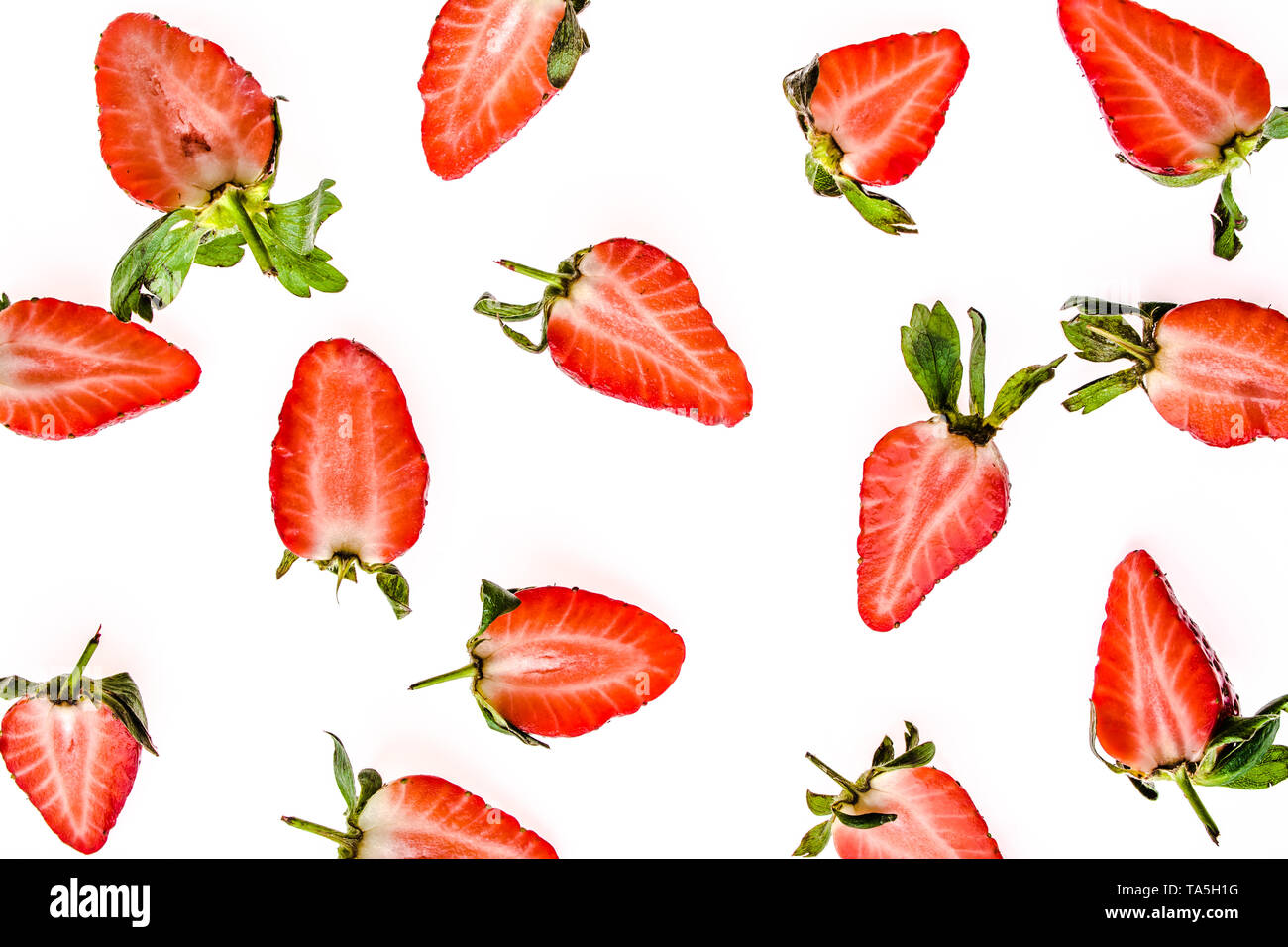 Fresh fruit pattern with strawberries, top view. Slices of strawberry isolated on white background. - Stock Image