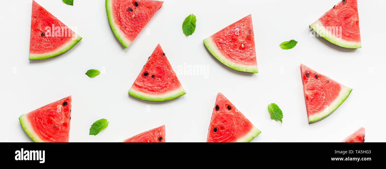 Creative scandinavian style flat lay top view of fresh watermelon slices on white table background copy space. Minimal summer fruits pattern for blog  - Stock Image