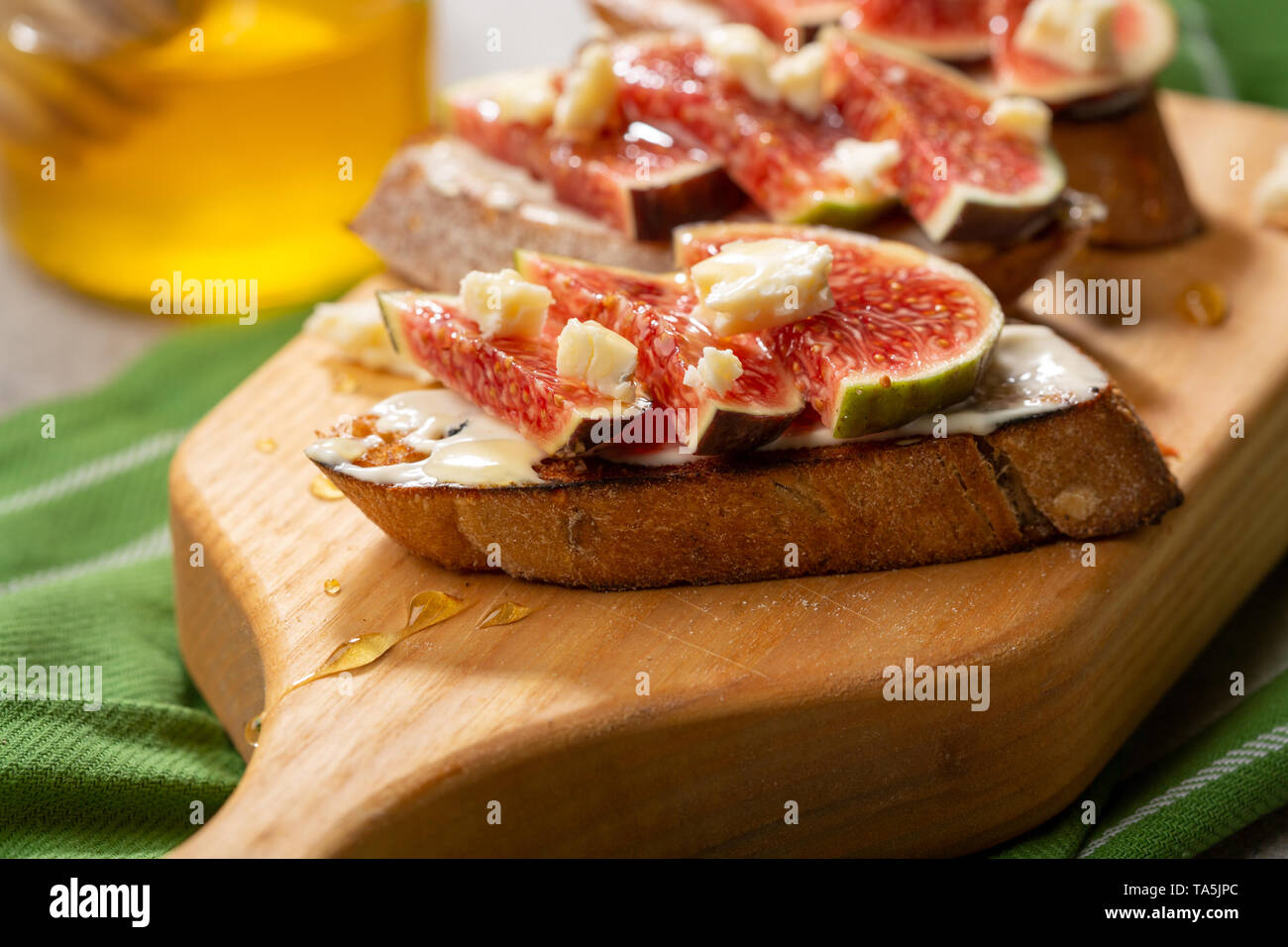 Sweet bruschetta with chese and figs - Stock Image