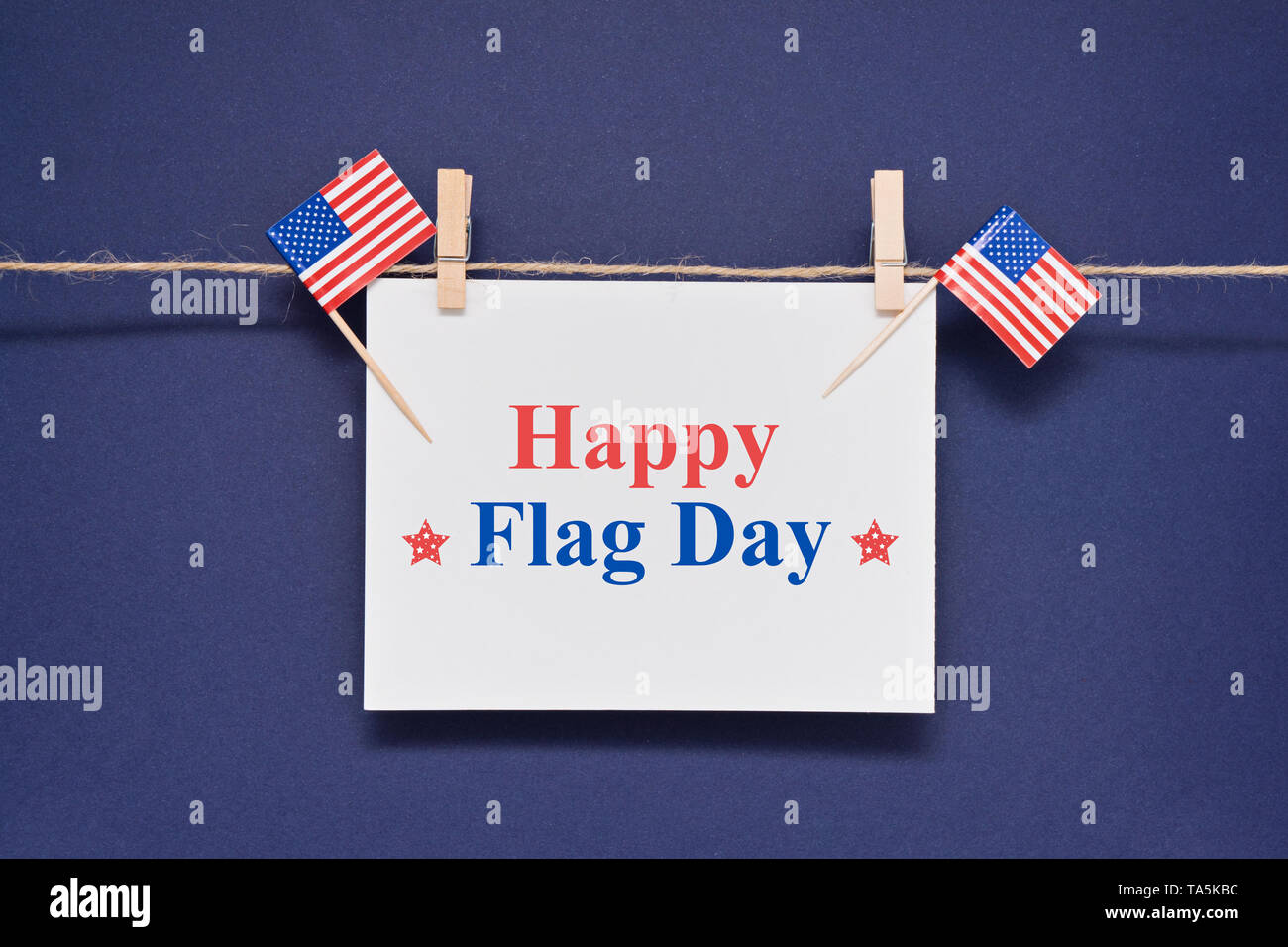 Greeting card with text Happy Flag Day for 14th June to celebrate adoption of Stars and Stripes as official flag of United States Stock Photo