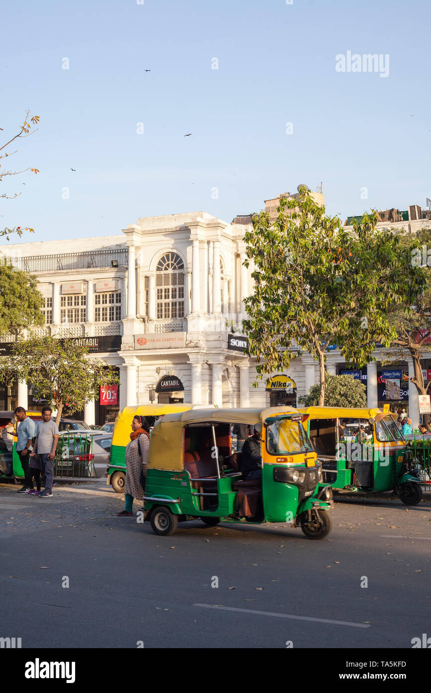 An autorickshaw Piaggio pictured in front of the typical building with Sony and Nikon showrooms at Connaught Pace in New Delhi, India on March 22, 201 - Stock Image