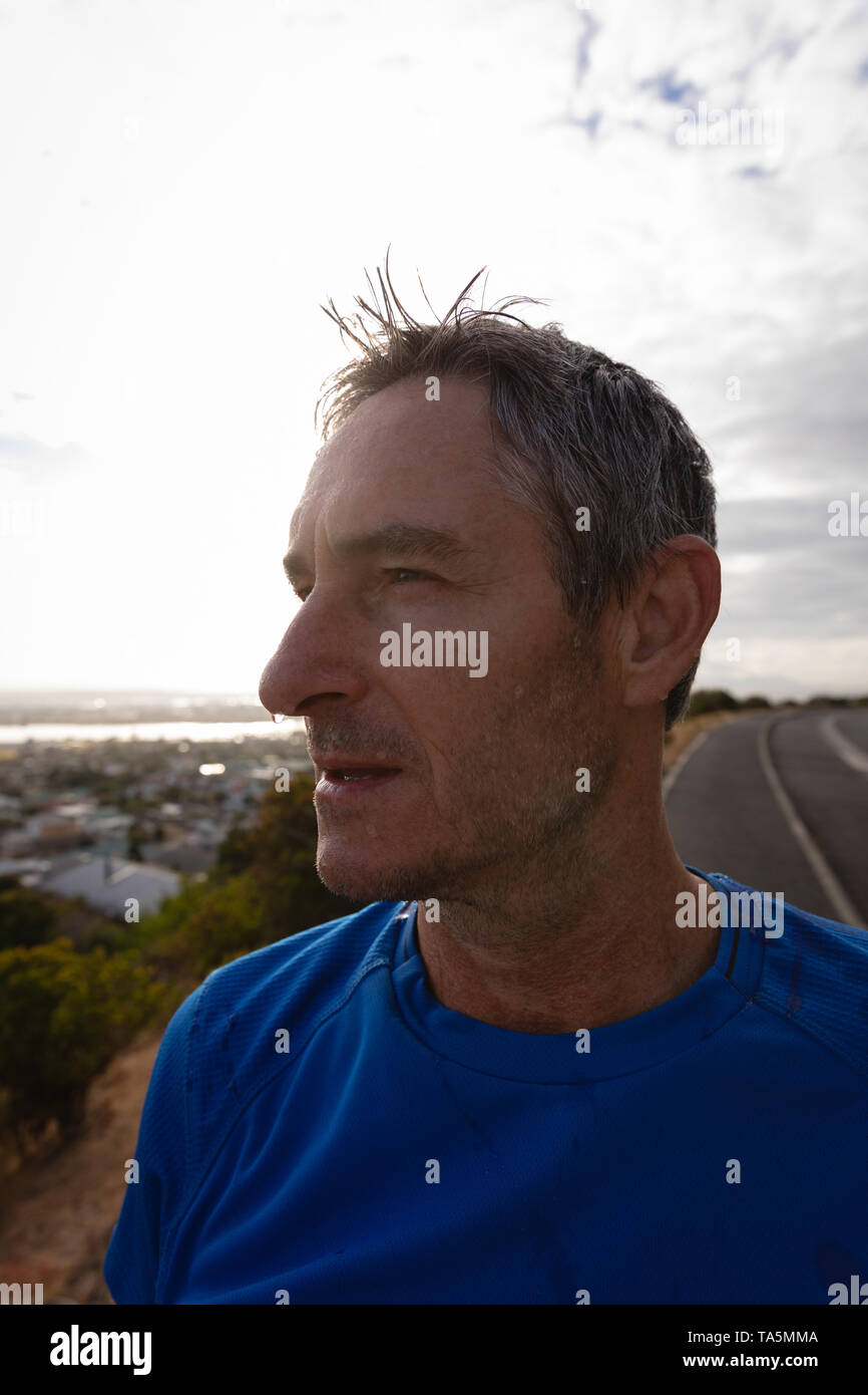 Exhausted mature man looking away - Stock Image