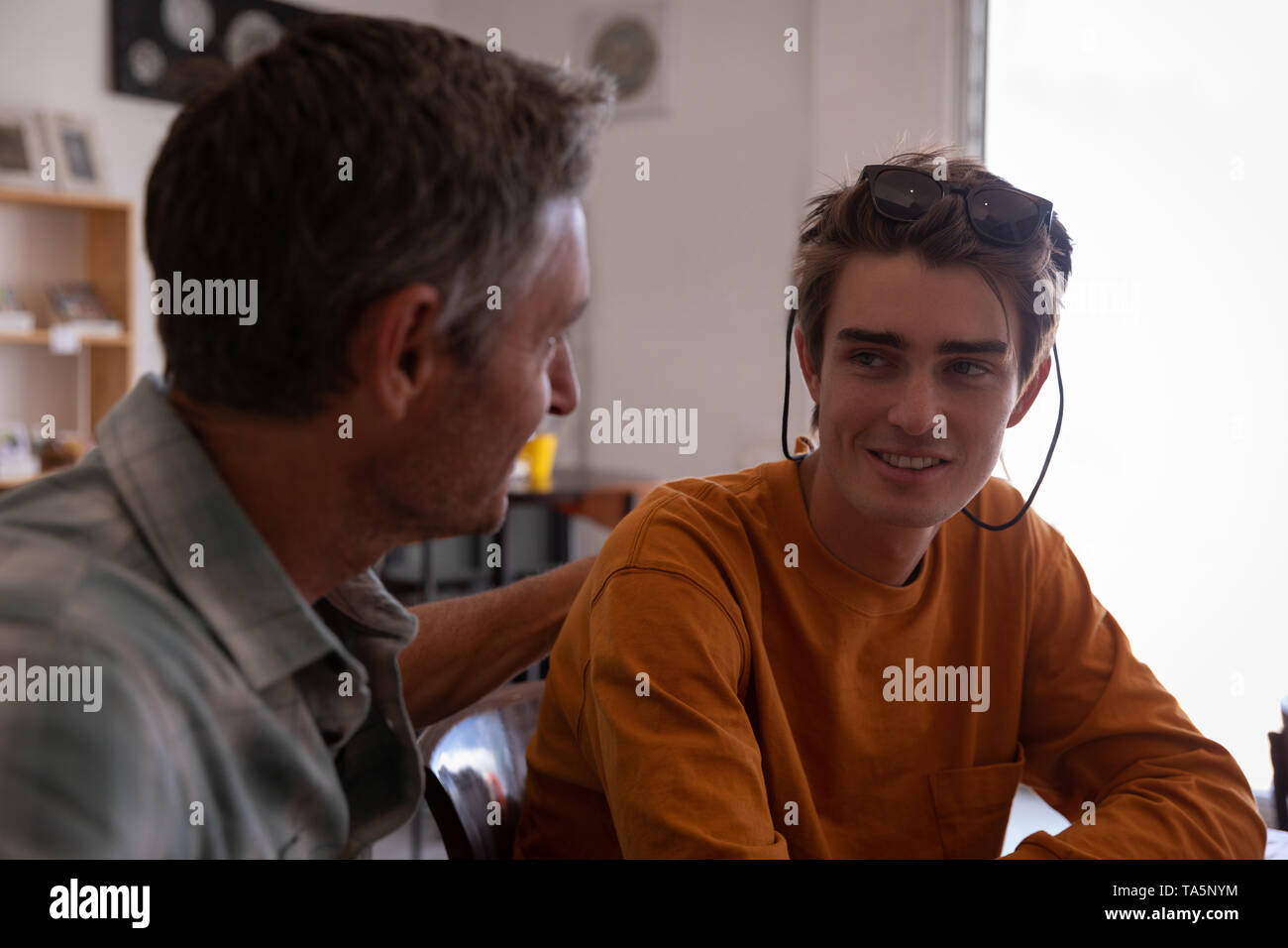 Father and son interact with each other - Stock Image
