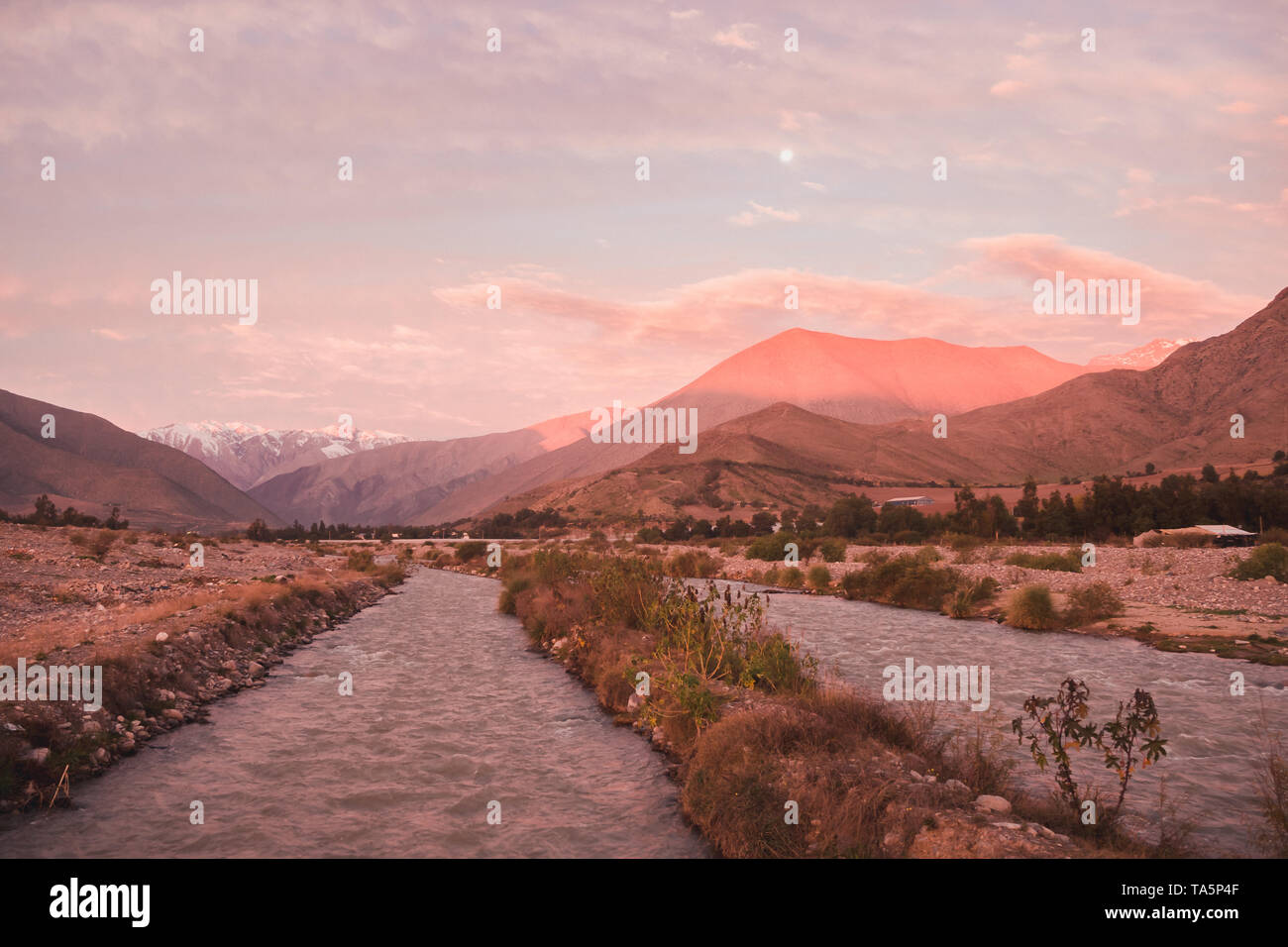 View of the Andes mountain range as seen from Vicuña in the Elqui Valley during the sunset sunrise in Chile - Stock Image
