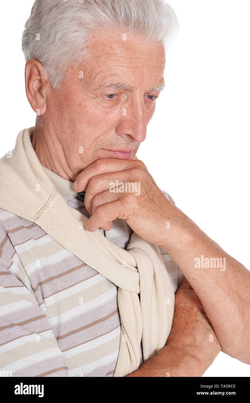 Portrait of thoughtful senior man on white background - Stock Image