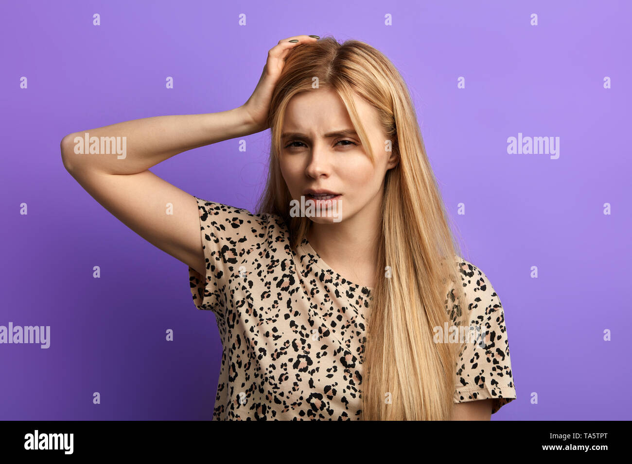 puzzled woman, scratching head, thinking, daydreaming, cannot remember some information. Human facial expressions. female student with bad memory.beau - Stock Image