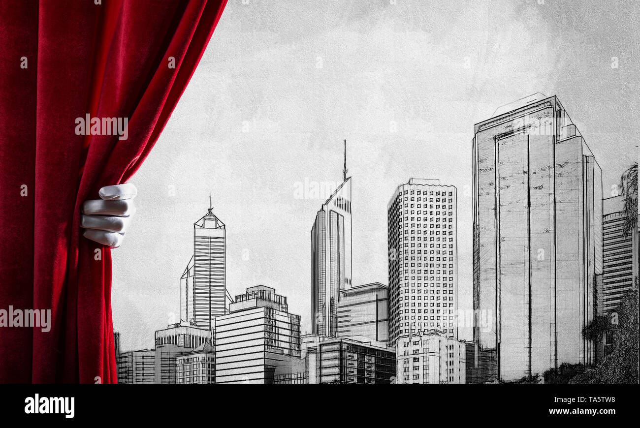 Modern drawn cityscape behind drapery curtain and hand opening it - Stock Image