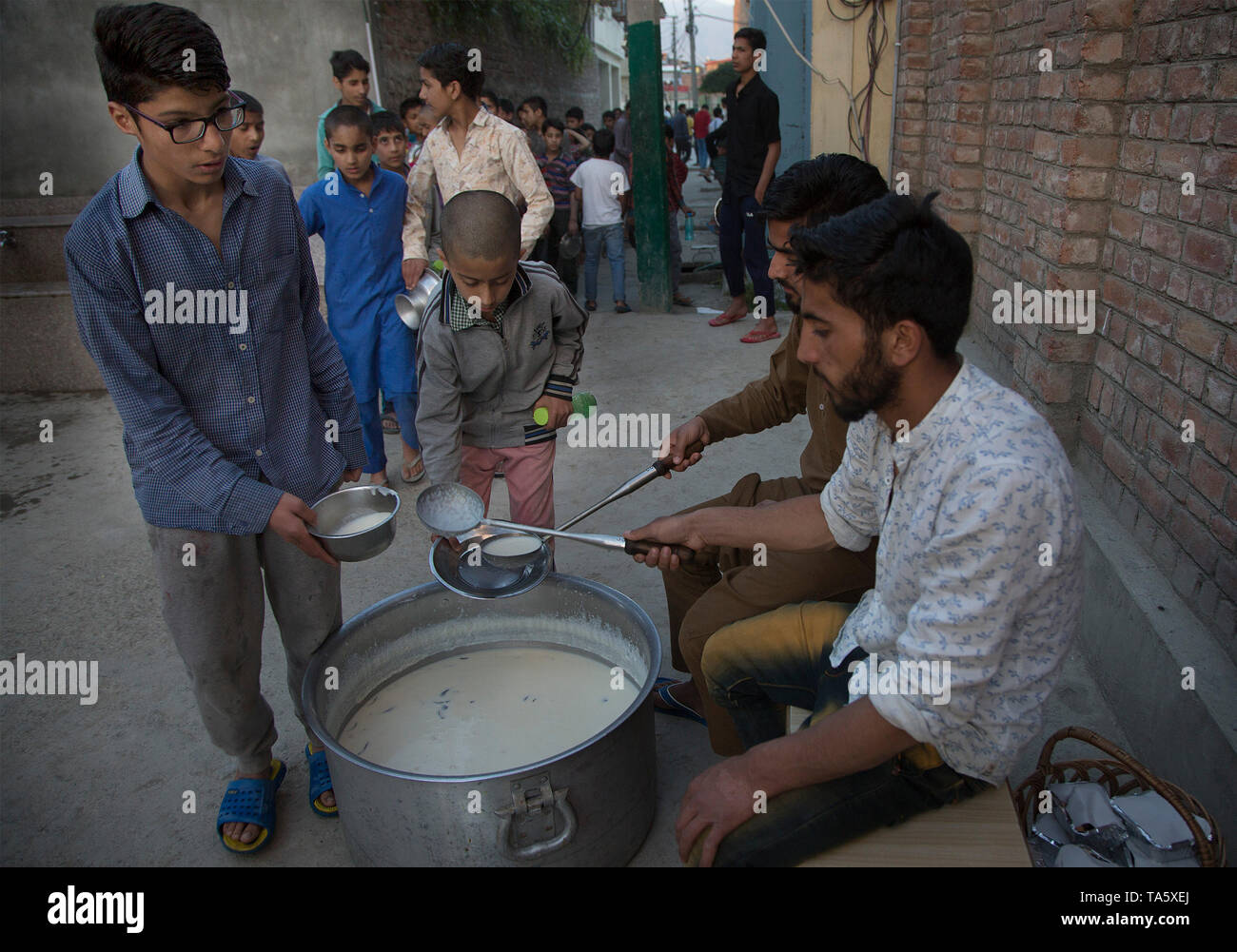Srinagar, Indian-controlled Kashmir. 21st May, 2019. Kashmiri Muslim orphans get food for Iftar, or fast-breaking meal, at an orphanage when Muslims break their fast during the holy month of Ramadan in Srinagar, the summer capital of Indian-controlled Kashmir, May 21, 2019. Credit: Javed Dar/Xinhua/Alamy Live News - Stock Image