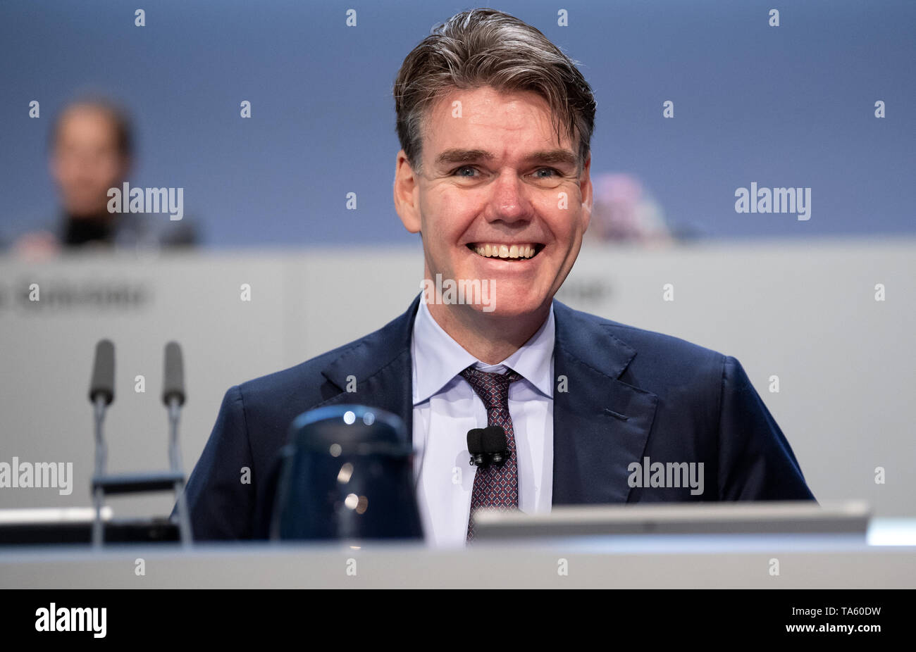 Munich, Germany. 22nd May, 2019. Joachim Drees, CEO of MAN SE, sits on the podium before the start of the Annual General Meeting. The bus and truck manufacturer now owns 95 percent of the VW subsidiary Traton SE, which plans to go public shortly. Credit: Sven Hoppe/dpa/Alamy Live News - Stock Image