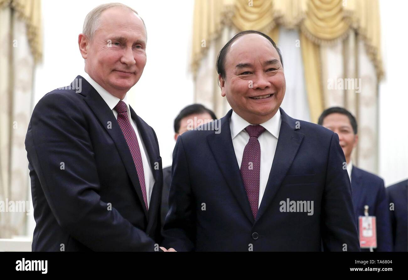Moscow, Russia. 22nd May, 2019. Russian President Vladimir Putin, left, greets Vietnamese Prime Minister Nguyen Xuan Phuc prior to their meetings at the Kremlin May 22, 2019 in Moscow, Russia. Credit: Planetpix/Alamy Live News - Stock Image