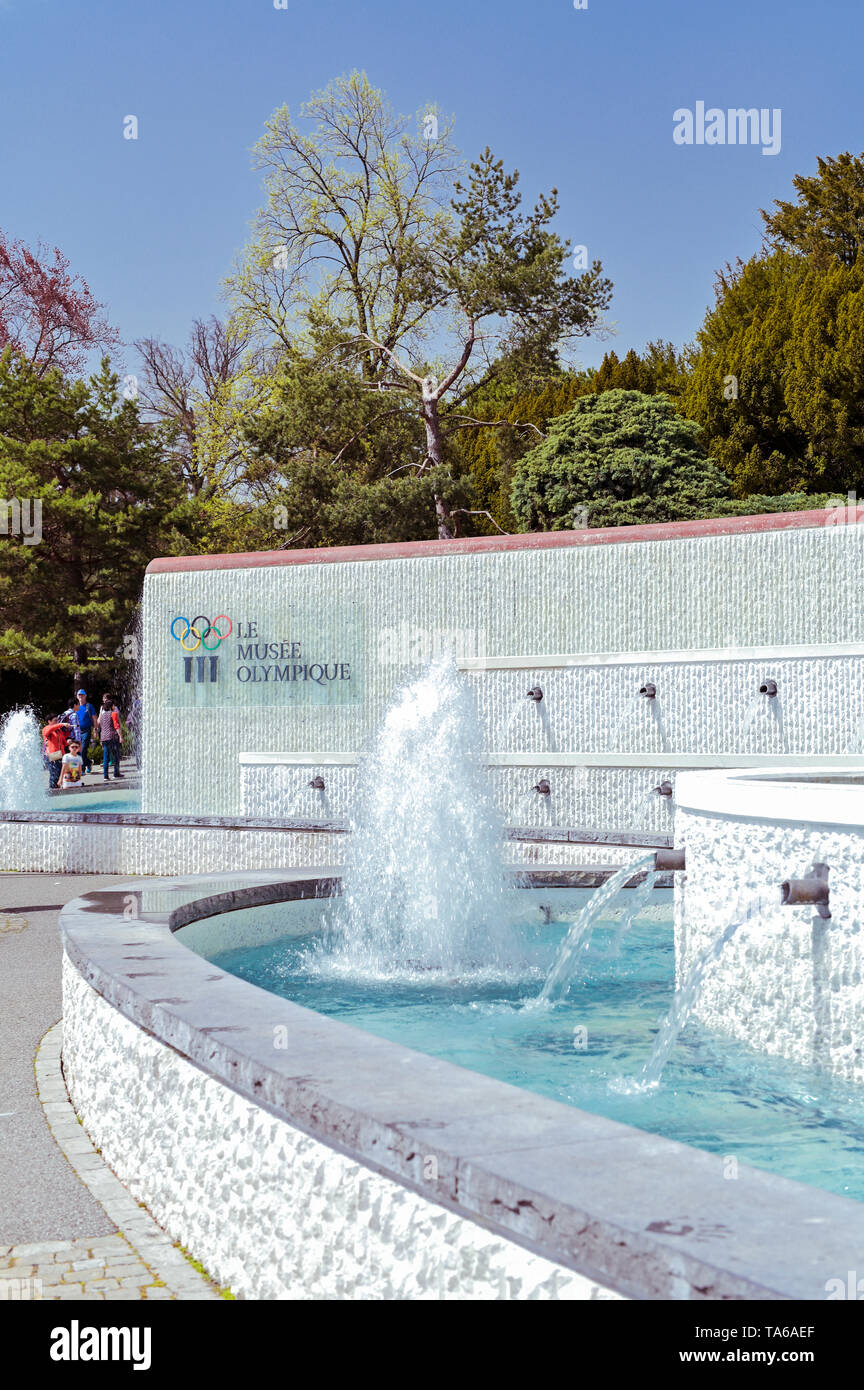 The central entrance with fountains in the park of the Olympic Museum in Switzerland - Stock Image
