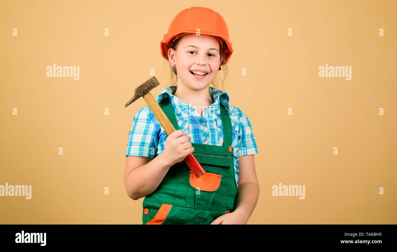 Initiative child girl hard hat helmet builder worker. Tools to improve yourself. Child care development. Future profession. Builder engineer architect. Kid builder girl. Build your future yourself. - Stock Image