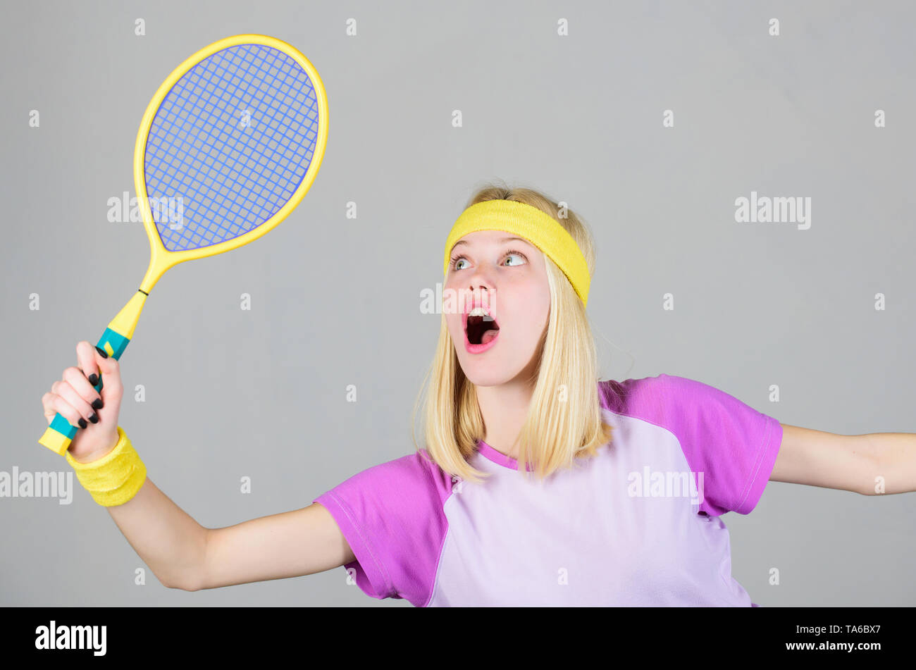 Active lifestyle. Sport for maintaining health. Woman hold tennis racket in hand. Tennis club concept. Tennis sport and entertainment. Active leisure and hobby. Girl fit slim blonde play tennis. - Stock Image