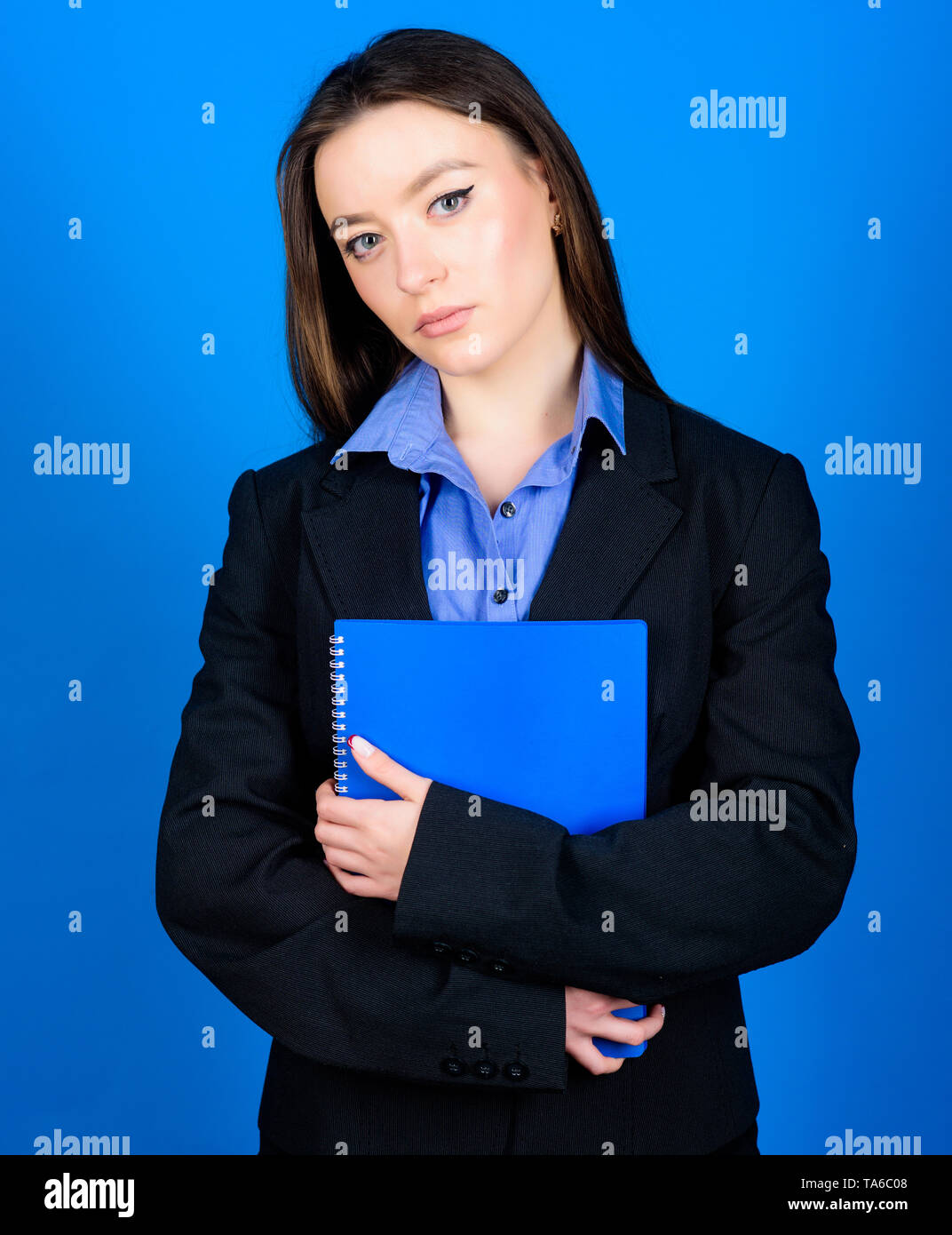 woman in jacket with paper notes. ready for lesson. education. businesswoman. student life. Smart beauty. nerd girl student in formal clothes. business fashion. Schoolgirl with document folder. - Stock Image