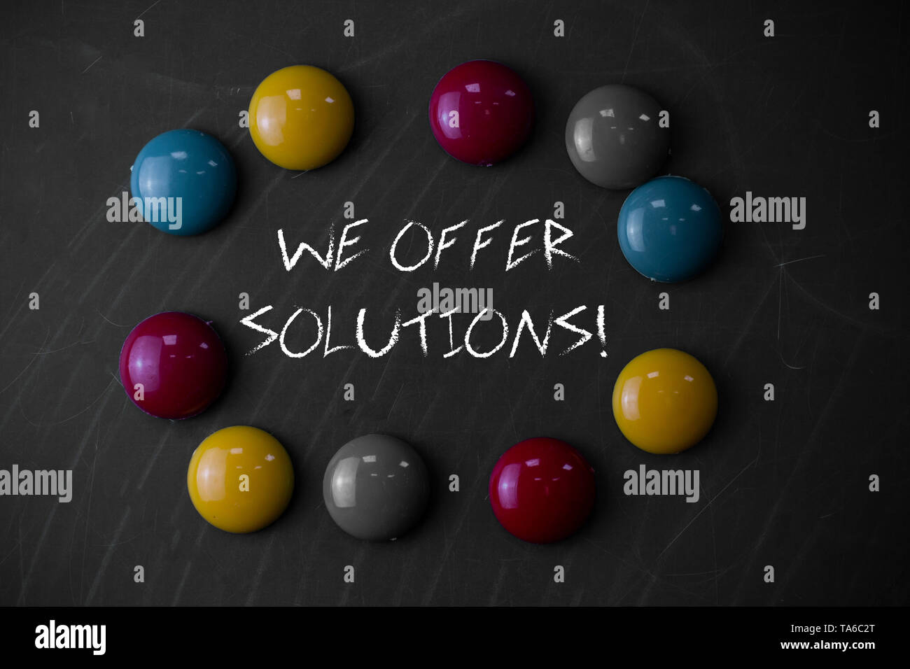 Writing note showing We Offer Solutions. Business concept for way to solve problem or deal with difficult situation - Stock Image