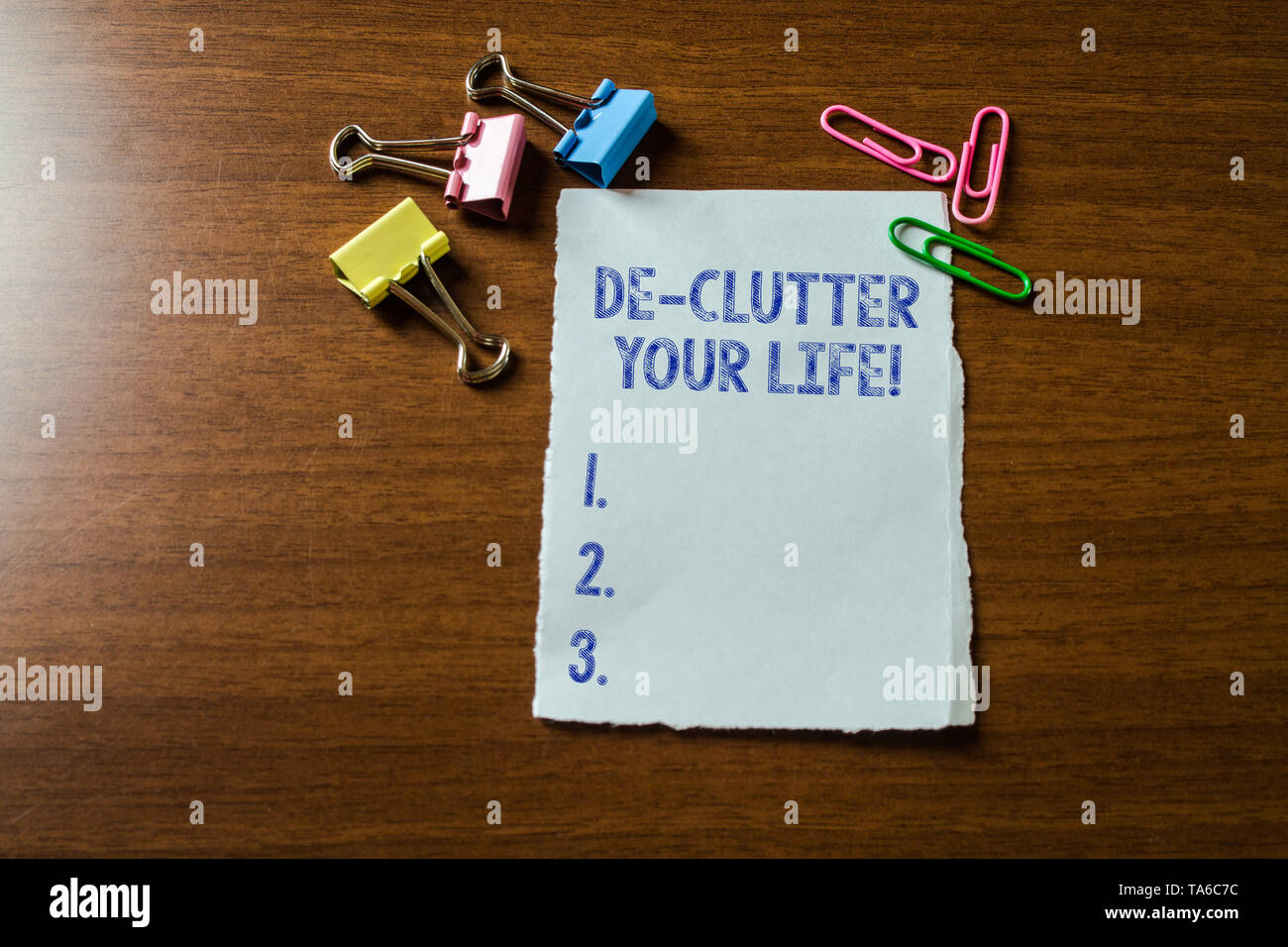 Handwriting text writing De Clutter Your Life. Conceptual photo remove unnecessary items from untidy or overcrowded places Blank stationary paper set  - Stock Image