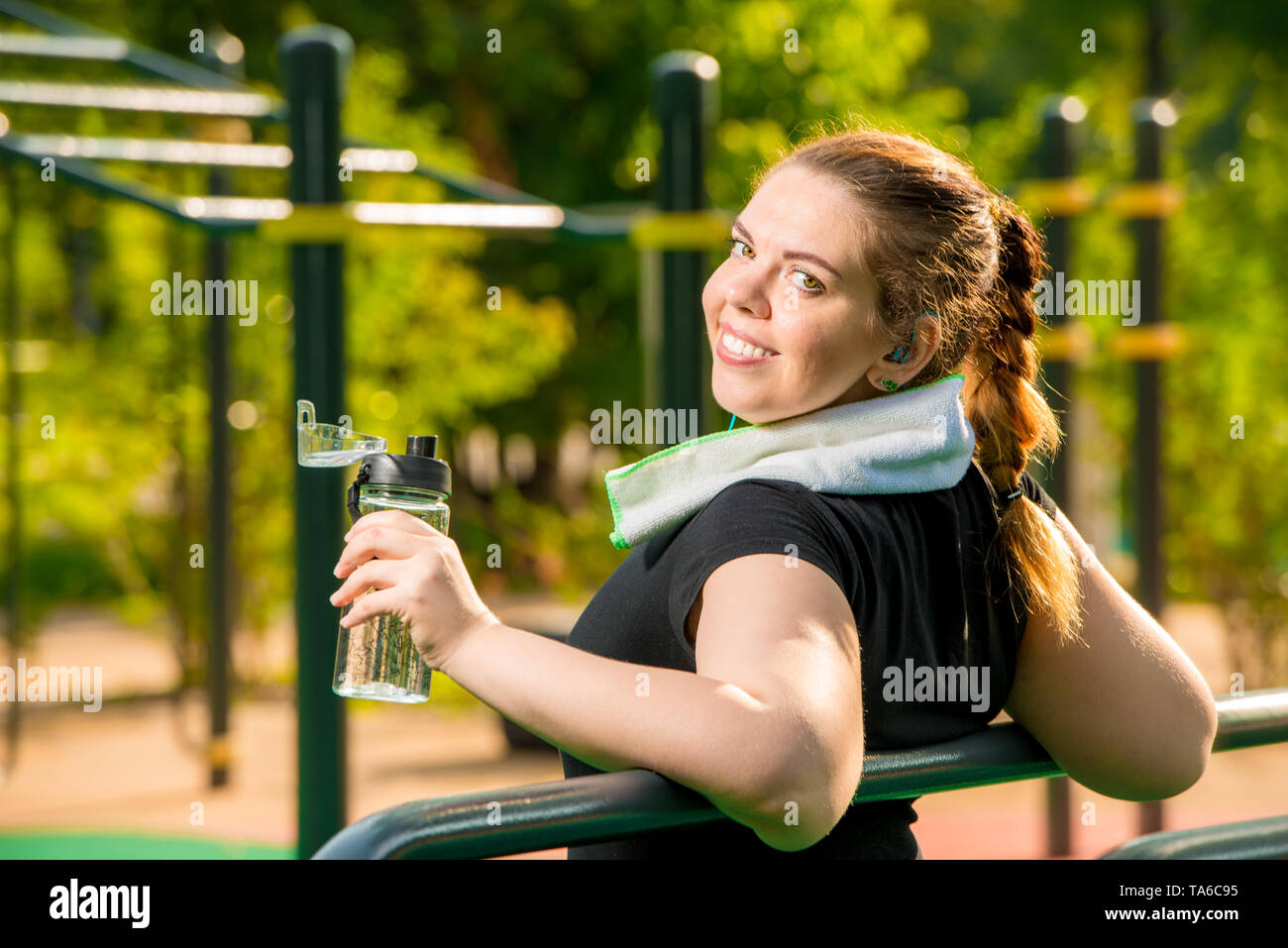 girl over size after workout resting, work on your body concept photo - Stock Image