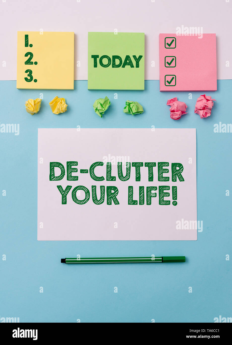 Writing note showing De Clutter Your Life. Business concept for remove unnecessary items from untidy or overcrowded places Note papers and stationary  - Stock Image