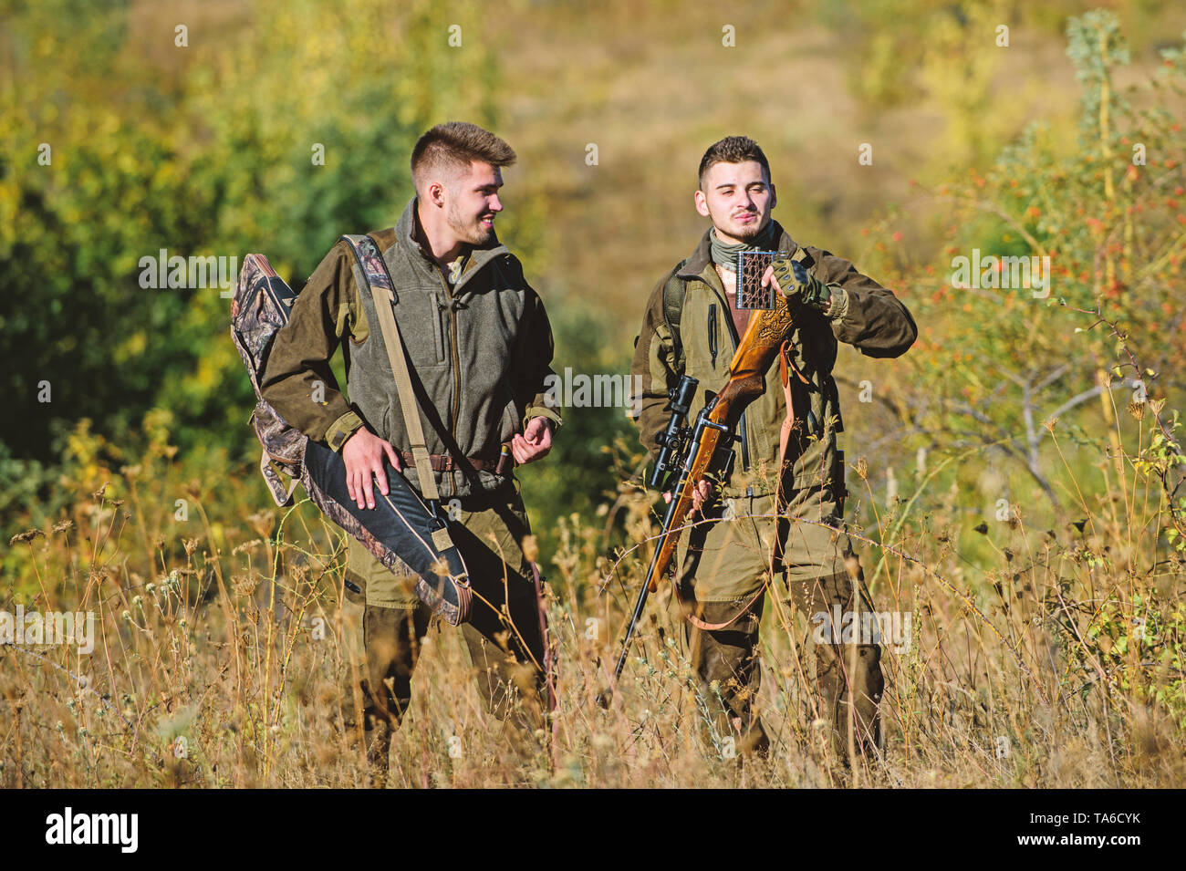 Army forces. Camouflage. Military uniform. Hunting skills and weapon equipment. How turn hunting into hobby. Man hunters with rifle gun. Boot camp. Friendship of men hunters. Rest for real men . - Stock Image