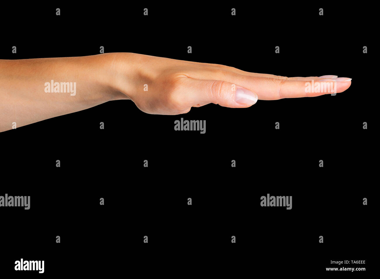 Female keep hand straight, side view. Isolated with clipping path. - Stock Image