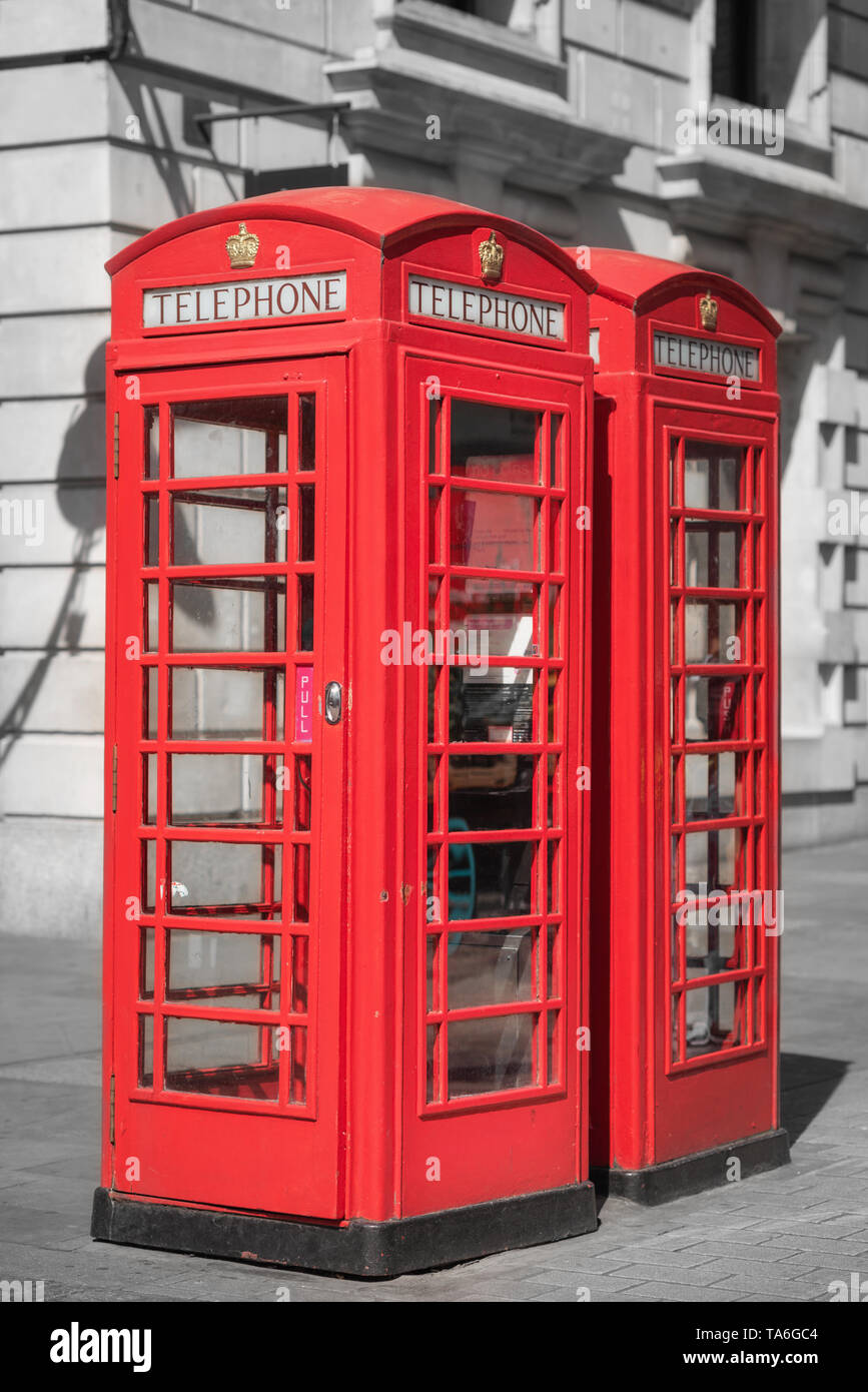 London, famous traditional red telephone box. United kingdom - Stock Image